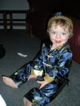 Photo of 19 month old grandson sitting in his blue Hmong jacket, pants and hat.