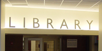 A sign that says library.