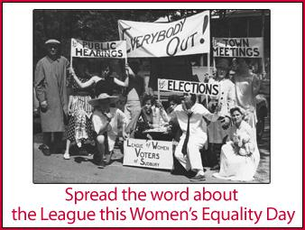 "A black and white photo of a group of men and women with signs indicating that they are the League of Women Votes getting people out to vote.  The text under the photo says: ""Spread the word about the League this Women's Equality Day""."