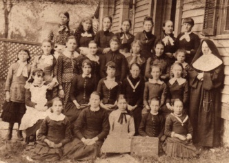 A black and white picture of a class from St Anthony High School.