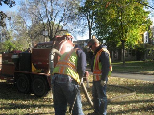 Picture of two men working on installing wiring on the boulevard